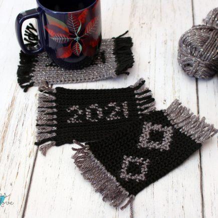 New Year's Crochet Mug Rugs with a coffee mug