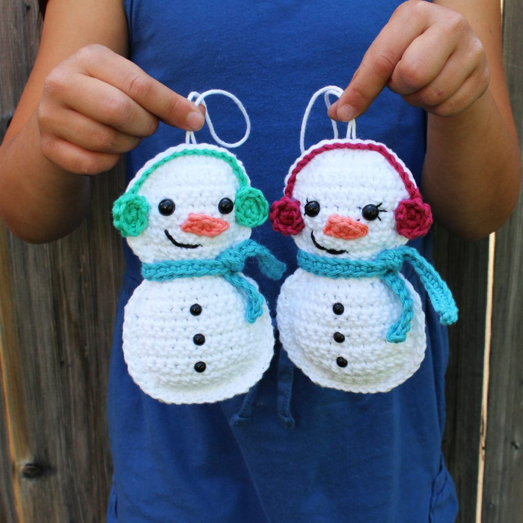 Hands holding crochet snowman ornaments - Christmas in July